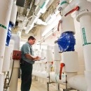 ClimateMaster geothermal installation on steroids.  This enormous manifold room moves millions of BTUs within a retirement facility.