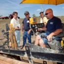 Mike Murphy (left), ACHR News, checks out directional boring operation at GeoFarm '10.