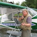 Before piloting the Piper Cub over Longmere Lake in Alaska, Mountainman Guff Sherman tells how he brought down the big Griz.