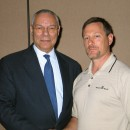 Keynote speaker Colin Powell greets an ex-Army journalist at a Bradford White sales meeting.