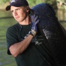 Chad Pregracke hoists some rubbish out of the Mississippi.  All part of a day's work at Living Lands & Waters.