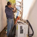 Santa Fe retrofit. Installers make quick work of a hi-SEER multizone installation.