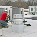 In Des Moines - a technician completes installation of Fujitsu multizone systems on the rooftop of Crestview Retirement.