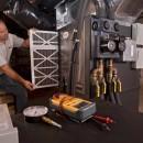 Vince Youndt checks a filter at a split system Tranquility 27 retrofit job.